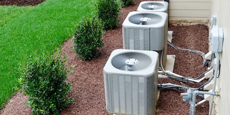 triple ac units outside building