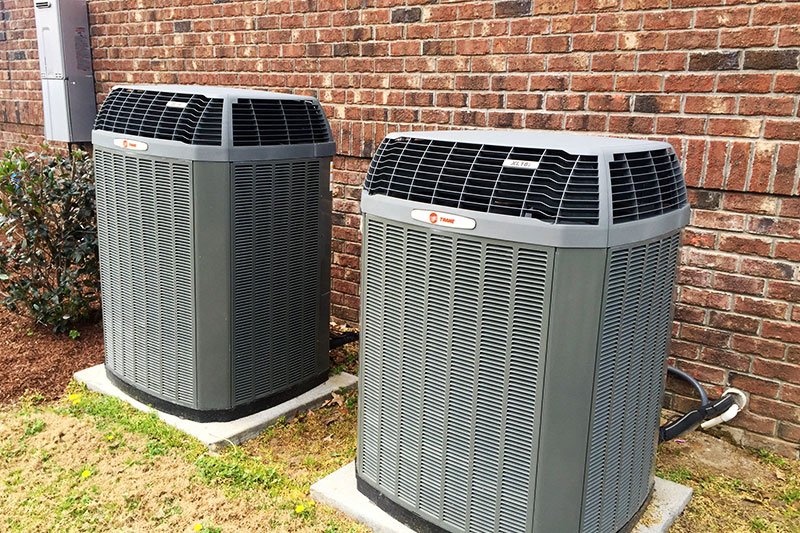 side by side trane ac units outside building